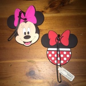 Two Disney luggage tags